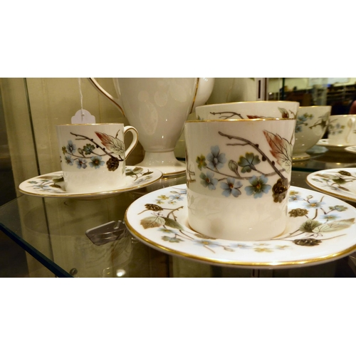 4 - A Wedgwood bone china Spring Morning pattern coffee set comprising five coffee cans and saucers, a c...