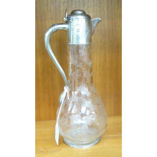 8 - A late Victorian silver mounted wine jug with an S-shaped handle, collar, cap and base, engraved wit...