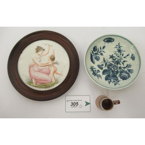 305 - An 18thC Worcester porcelain saucer, decorated in blue and white with flora and insects; a Doulton L...