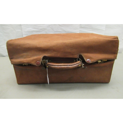 10 - An early 20thC moulded and stitched pigskin vanity case with lacquered brass fittings and a watered ...