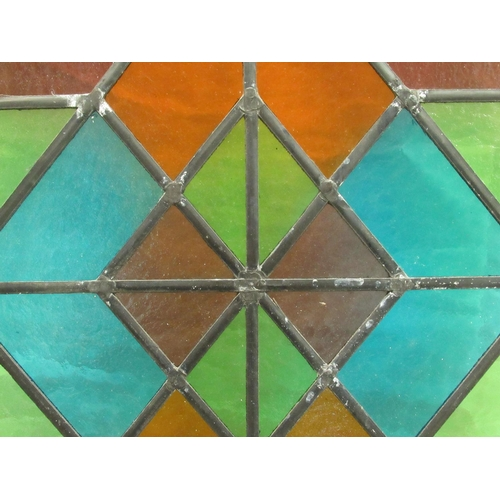 11 - An early 20thC red and green lead glazed window panel 28