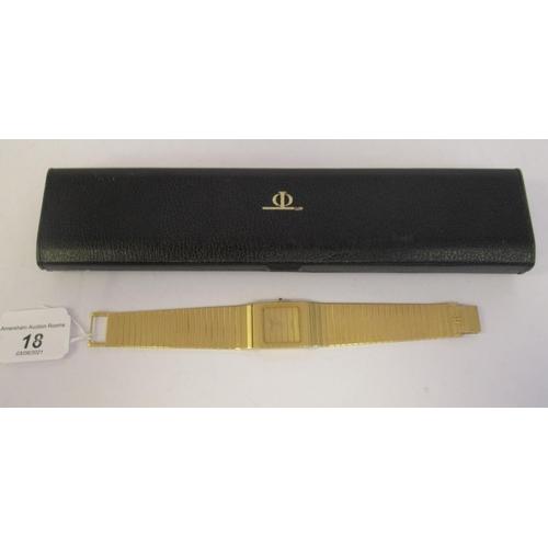 18 - A Baume & Mercier 18ct gold designer bracelet wristwatch, the quartz movement faced by a square ...