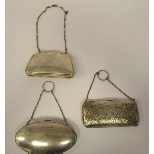 13 - Three dissimilar late 19th/early 20thC silver folding purses on chain handles, enclosing hide lined ...