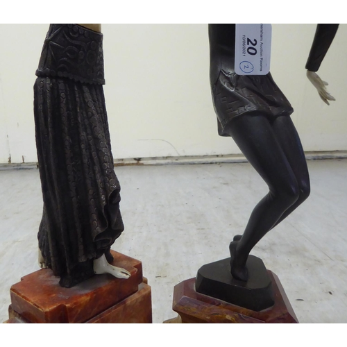 20 - Two Art Deco inspired resin and bronzed finished figures, dancers in period costume, on stepped marb...