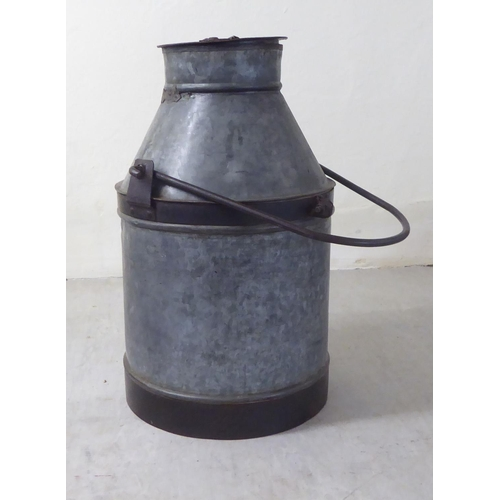 22 - A galvanised iron and rivetted steel bound milk churn 20.5