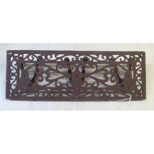25 - A modern cast iron wall mounted, triple hook coat rail 17