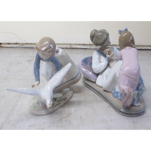 3 - Seven items of Lladro porcelain: to include two children in a rocking crib 7