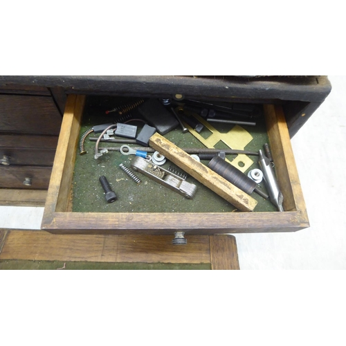 30 - An early 20thC 'Neslein' oak tool chest with a removeable front panel, enclosing an arrangement of e...