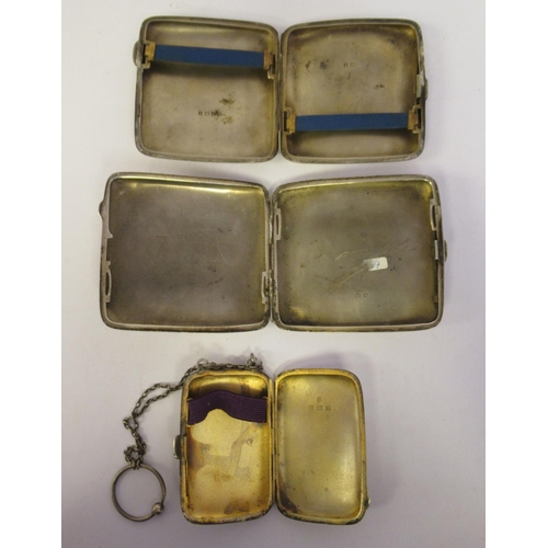 37 - Three similar silver cushion shaped, folding cigarette cases, one with a chain handle mixed marks