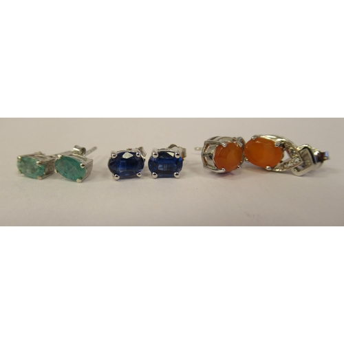 39 - Thirteen pairs of Sterling silver and gemstone set earrings: to include emeralds and green diamonds