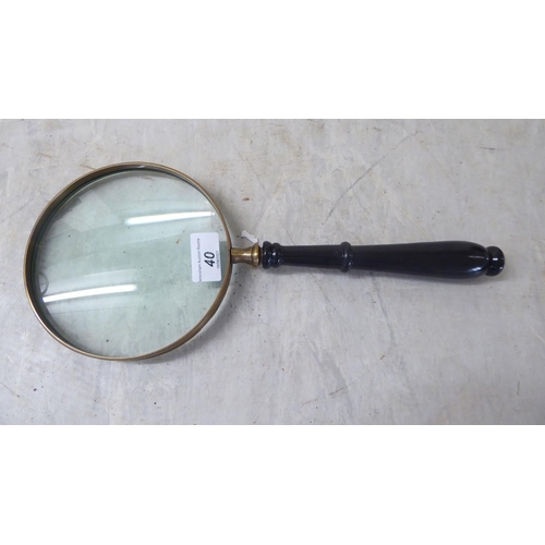 40 - An oversized magnifying glass, on a turned wooden handle 15