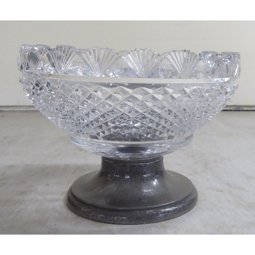 42 - A cut glass centrepiece with shell and repeating diamond shaped formations 9