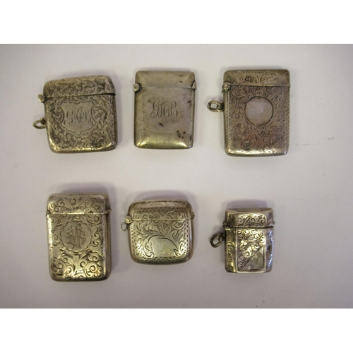 49 - Five similar silver vesta cases with hinged caps and strike plates mixed marks