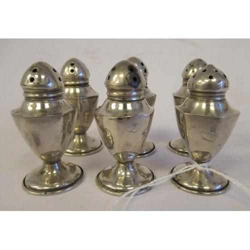 50 - A set of six Continental silver coloured metal hexagonal shape pedestal pepper pots indistinct...