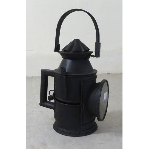 54 - A reproduction of a black painted iron railway signal lamp 12