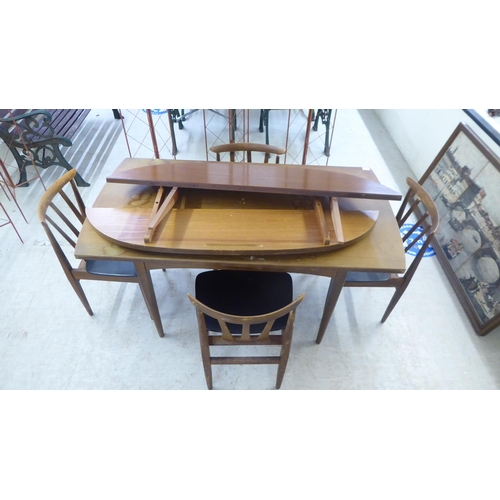 55 - A 1950/60s teak table with two associated demi-lune ends, raised on tapered legs 28