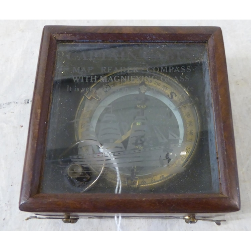 58 - A reproduction of a circa 1906 brass cased and glazed compass boxed