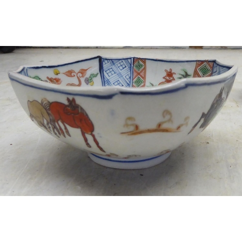 60 - Oriental ceramics: to include an early 18thC Chinese porcelain, twin handled mug and cover, decorate...