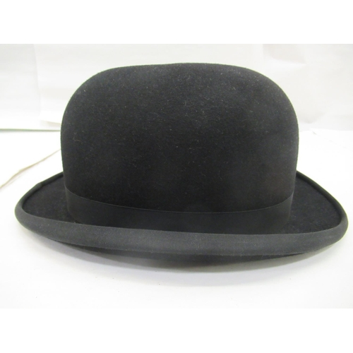 11 - A Christies of London black bowler hat, interior size label 7.5 59