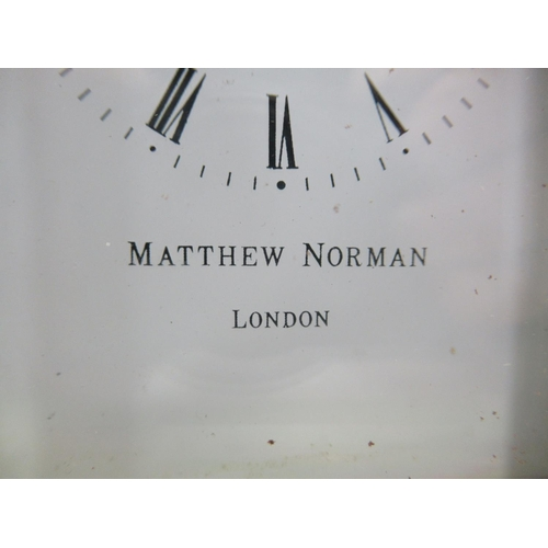 13 - A Matthew Norman of London lacquered brass cased carriage timepiece with bevelled glass panels and a...
