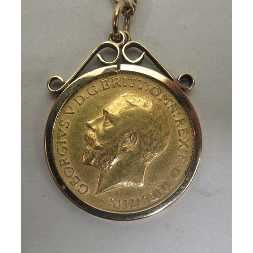1 - A George V sovereign, St George on the obverse 1912, in a 9ct gold mount, on a fine neckchain&...