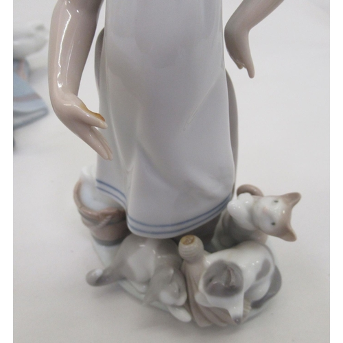 17 - Seven Lladro porcelain figures: to include a young woman, carrying a lamb 11