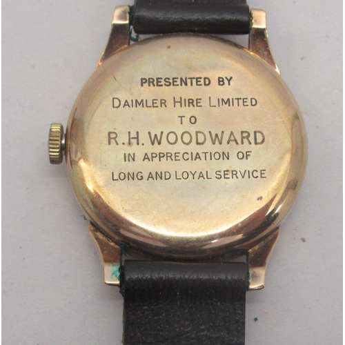 24 - A mid 20thC 9ct Smiths De Luxe gold cased wristwatch, faced by an Arabic and baton dial with subsidi...