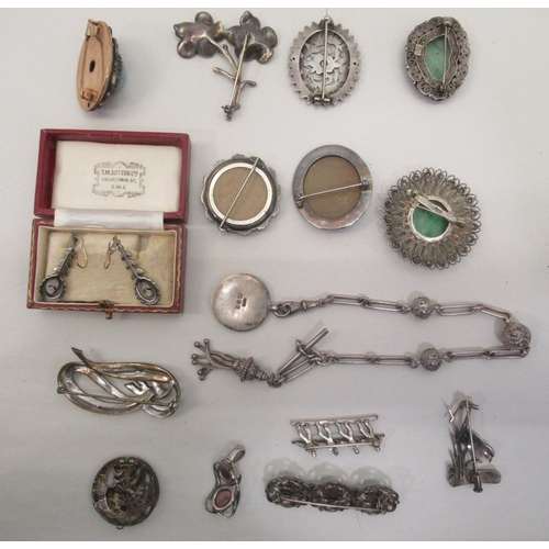 25 - Items of personal ornament: to include silver and silver coloured metal brooches mixed marks, ...