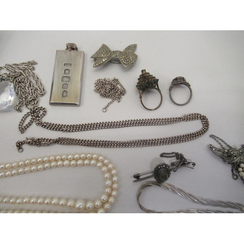 29 - Silver, pearls and other items of personal ornament: to include an ingot; and a pair of paste set ea...