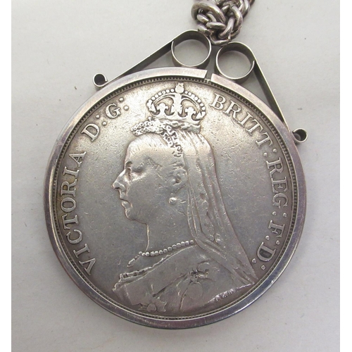 31 - A George IV crown 1821; a Victorian crown 1891, in a silver mount, on a fine neckchain; and a Vict...