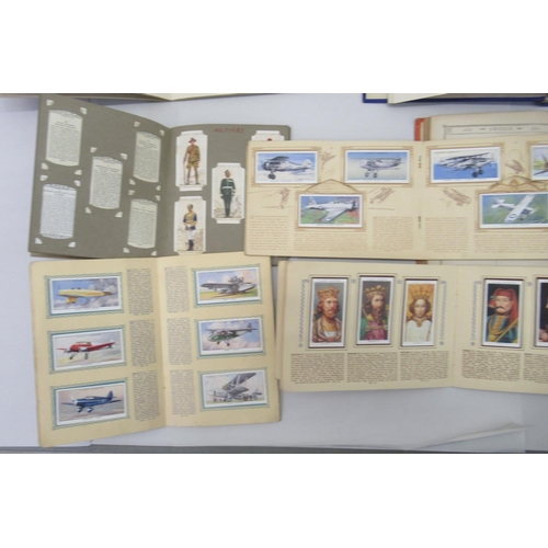 34 - 20thC collectables: to include Matchbox sleeves; Players and other cigarette cards; and a schoolboy ...