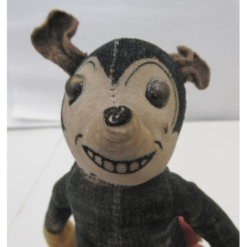 4 - A circa 1930s stuffed, stitched, fabric toy 'Mickey Mouse' with mobile limbs bears a label Dea...