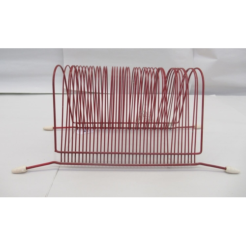 43 - A 1970s red painted wire, forty division record stand, on splayed feet 6