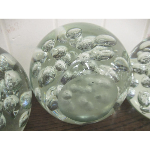 45 - A set of four clear glass door stops with interior bubbled ornament 5
