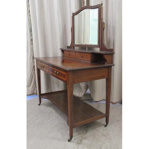 5 - An Edwardian Maple & Co ebony inlaid crossbanded and string inlaid mahogany dressing table, surm...