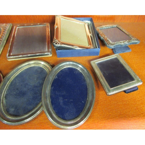 59 - Four modern silver plated, glazed photograph frames largest 6