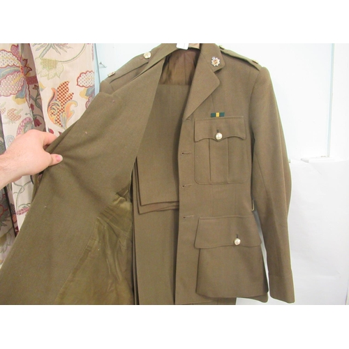 6 - Two military uniforms; and a pair of size 10 black riding boots