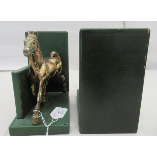 7 - A pair of modern green hide covered bookends, surmounted by trotting brass horses 7