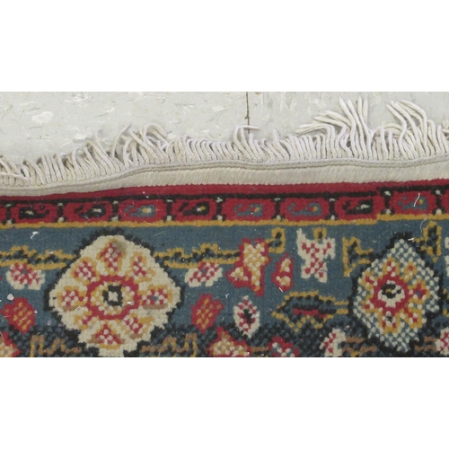 51 - A Persian design rug, decorated with stylised ornament 30