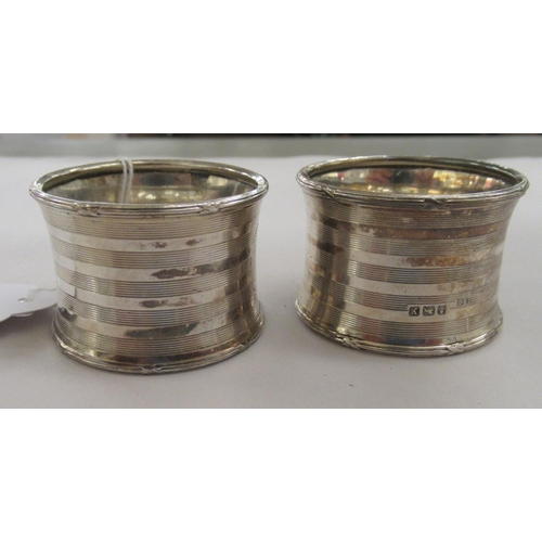 54 - A pair of silver napkin rings of waisted form with engine turned decoration Birmingham 1923&nb...