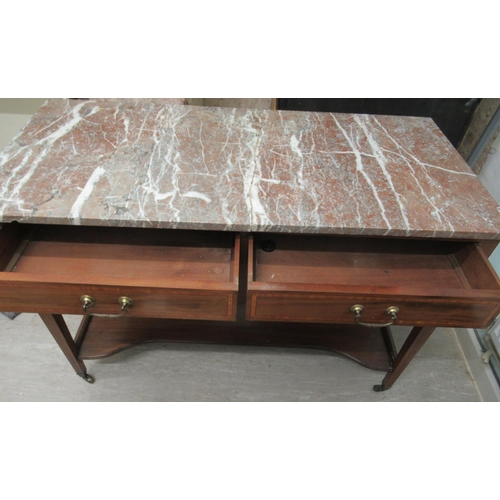 9 - An Edwardian ebony crossbanded and string inlaid washstand, the (broken) marble top, over two in-lin...