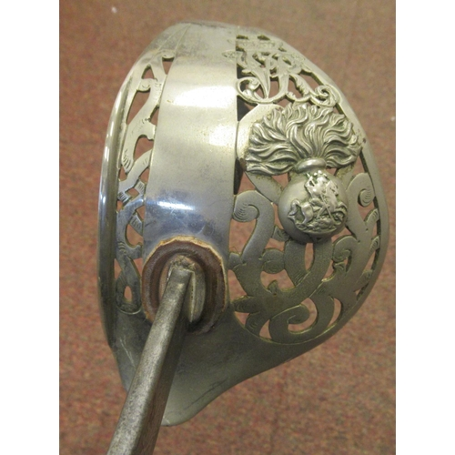 12 - An early 20thC British military dress sword with a wire bound, shagreen covered handgrip, a pierced,...