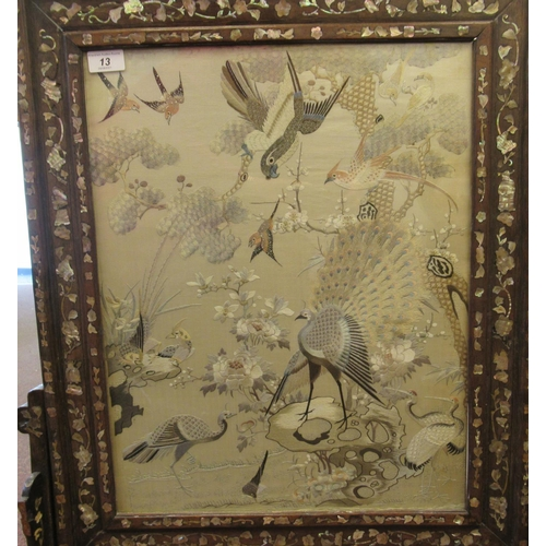 13 - An early 20thC Chinese silk tapestry panel, featuring a display of exotic birds amid flora and folia...