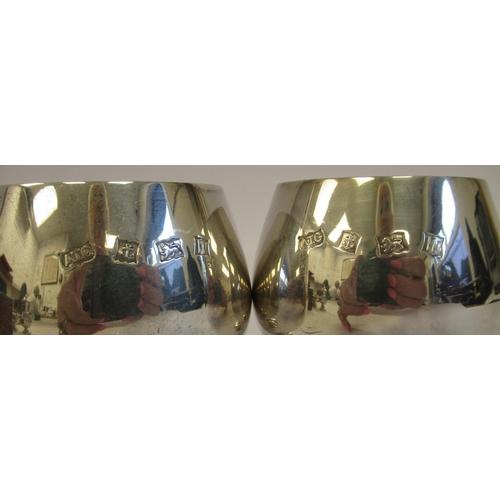 14 - A pair of silver brandy balloon design pedestal goblets with gilt interiorsA.T Cannon&nb...