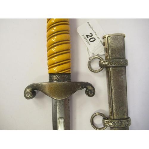 20 - A German Third Reich officer's dress dagger with oakleaf ornament, a ribbed orange phenol handgrip a...