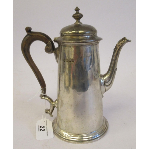 22 - A Georgian style silver coffee pot of tapered form with an S-shaped spout, hinged domed lid, finial,...