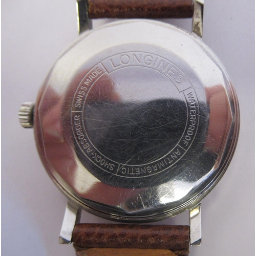 25 - A Longines stainless steel cased wristwatch, the automatic movement with sweeping seconds, faced by ...