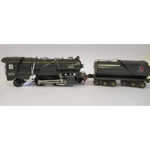 28 - A Lionel Corporation NY, Lionel Lines 0 gauge electric 2-4-2 model railway locomotive and tender in ...
