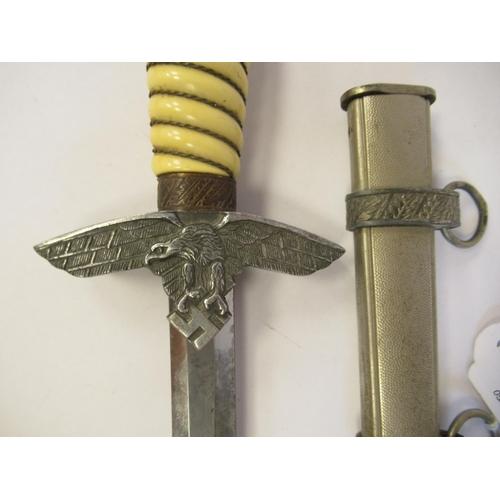 32 - A German Third Reich era 2nd pattern Luftwaffe officer's dress dagger, the ball pommel with a swasti...