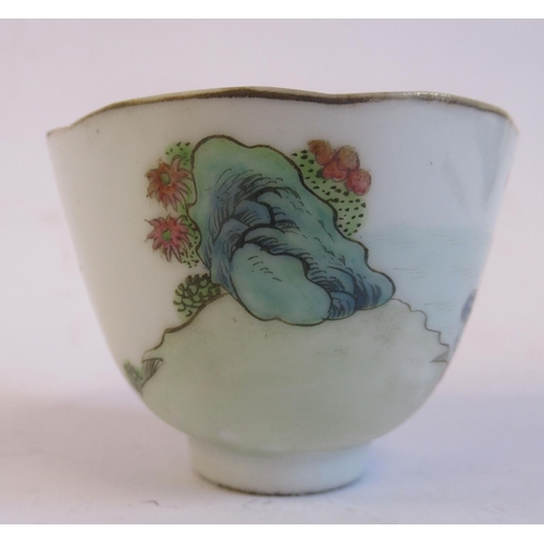 42 - A 19thC Chinese porcelain footed wine cup, decorated in famille rose with figures and birds 1....